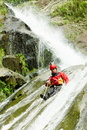 Canyoning instructor waterfall descent by a professional istructor Stock Images