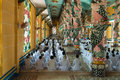 Cao dai temple ho chi minh city vietnam dec people praying in on dec in caodai is a vietnamese religion mixing Stock Image