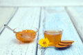 The cap of camomile tea on wooden table Royalty Free Stock Images