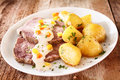 Cap of rump with roast potatoes Royalty Free Stock Photo