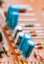 Capacitors resistors and other electronic components mounted on motherboard Stock Image