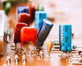 Capacitors resistors and other electronic components mounted on motherboard Stock Photography