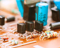 Capacitors resistors and other electronic components mounted on motherboard Stock Photo