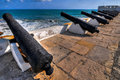 Cape coast castle ghana cannons overlooking from is a fortification in built by swedish traders for trade in Stock Image
