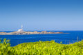 Cape favaritx in sunny day at menorca island spain Stock Photography