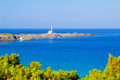 Cape favaritx in sunny day at menorca island spain Stock Photos
