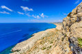 Cape greco view an early summer day at in cyprus from a high pont with a hiking path leading from the rocky headland and sea in Stock Photo