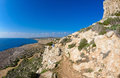 Cape greco view a young woman and her dog looking from a viewpoint on a walking trail of in the famagusta area of cyprus Royalty Free Stock Photography