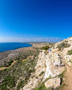 Cape greco view a young woman and her dog looking from a viewpoint on a walking trail of in the famagusta area of cyprus Royalty Free Stock Image