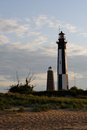 Cape henry lighthouses the old and new at sunset in virginia beach va Royalty Free Stock Image