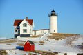 Cape neddick lighthouse old york village maine nubble at in winter usa Royalty Free Stock Images