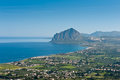 Cape san vito and cafano bay sicily ws sweeping view across to north west housing farms side by side the azure blue Royalty Free Stock Photos