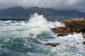 Cape town waves rough seas crash onto rocks at kalk bay near Stock Photography