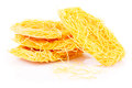Capellini pasta raw in coils over white background Stock Photos