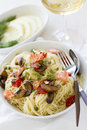 Capellini pasta with salmon and vegetables tomatoes capers mushrooms Royalty Free Stock Images