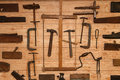 Ancient Carpenter Tools on a wooden wall Royalty Free Stock Photo