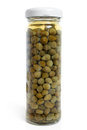Capers canned in glass jar on a white background Royalty Free Stock Photo