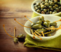 Capers on wooden table closeup Stock Photo