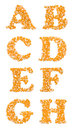 Capital characters made of corn seeds letter set letters a b c d e f g h Royalty Free Stock Photo