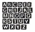 Capital letters of the English alphabet, white chalk, black coal.