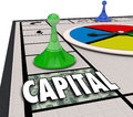 Capital word board game win financing funding business startup on a with piece moving forward to and for a new or company venture Royalty Free Stock Photo
