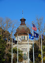 Capitol is flanked by flags flying including the state flag mia coastguard and american Royalty Free Stock Image