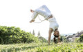 Capoeira woman awesome stunts in the outdoors Royalty Free Stock Photos
