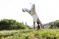 Capoeira woman awesome stunts in the outdoors Stock Images