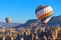 Cappadocia balloons flying over rock landscape at turkey Stock Images