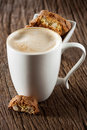 Cappuccino and cantuccini a cup of fine pastry on a wooden background Stock Photos