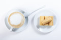 Cappuccino with chocolate chip, wafer rolls, white cup, close-up Royalty Free Stock Photo