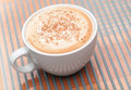 Cappuccino coffee with spice in a white cup Stock Photo