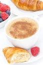 Cappuccino croissant fresh raspberry for breakfast top view and vertical Royalty Free Stock Image