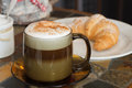 Cappuccino cup of with croissant Stock Image