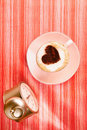 Cappuccino with heart, red stripy table Royalty Free Stock Photo