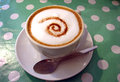 Cappuccino a relaxing cup of with a chocolate swirl Stock Image