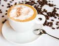 Cappuccino with whipped cream and coffee beans Stock Photography