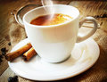 Cappucino cup italian coffee of with beans and a cinnamon sticks Royalty Free Stock Photography
