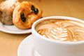 Cappucino and pastries decorative Stock Photo