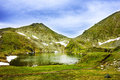 Capra lake and fagaras mountains in romania landscape from Royalty Free Stock Photography