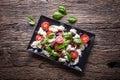 Caprese Salad.Mediterranean salad. Mozzarella cherry tomatoes basil and olive oil on old oak table. Italian cuisine Royalty Free Stock Photo