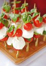Caprese salad skewers with tomato and mozzarella with basil Stock Photography