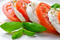 Caprese salad tomato and mozzarella slices with basil leaves Royalty Free Stock Images