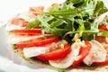 Caprese sallad med rocket salad Arkivfoton
