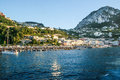 Capri italy the beautiful island of in seen from the sea the small port with many boats of vacationers attractive holiday Stock Image