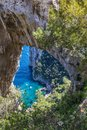 Capri Italy, island in a beautiful summer day, with faraglioni rocks and natural stone arch. Royalty Free Stock Photo