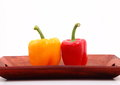 Capsicum capsicums on the wooden tray Stock Photos