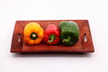 Capsicum capsicums on the wooden tray Royalty Free Stock Images