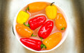 Capsicums - washing vegetables sink Royalty Free Stock Photo