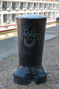 Capstan with cartoon smiling face graffiti Royalty Free Stock Photography